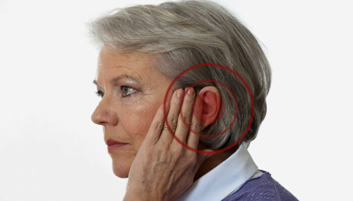tinnitus ringing in mature woman's ear