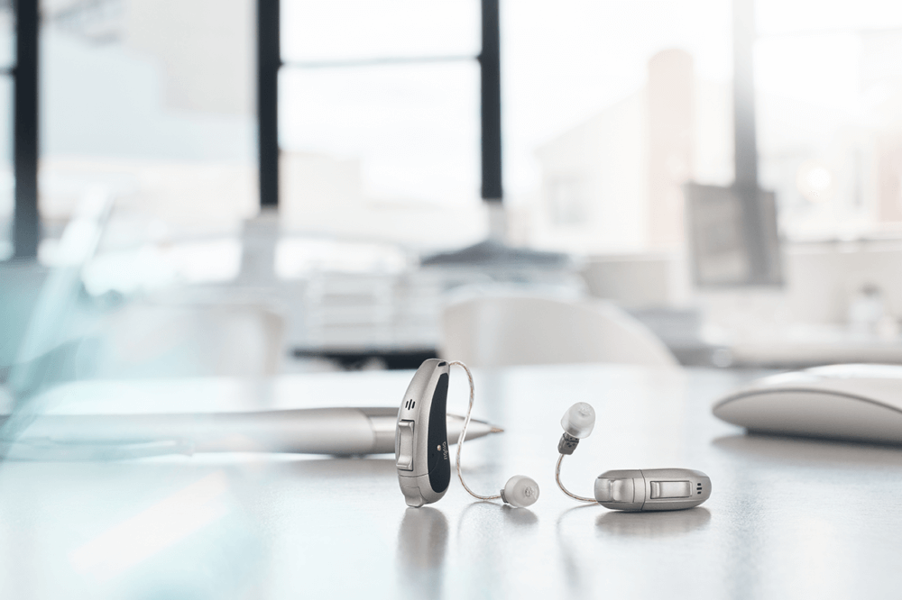 small hearing aids on desk
